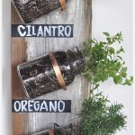 unique interior apartment herb garden design using trasnparent bottles with black board for names
