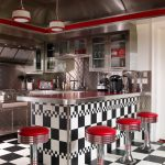 unique plaid pattern retro style appliance with red stools and black white kitchen bar and red ceiling accent