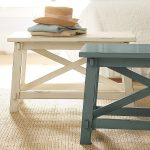 unique scandinavian skinny side table idea in dull white and navy blue color with throw on jute rug
