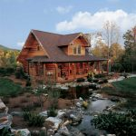 unique single log cabin style home design with small river in the front and brown color with poles and glass window accent
