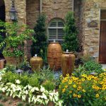 unique stone house design with arched window and garden idea with front yard fountains idea