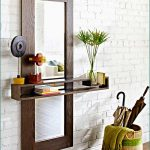 unique wall mirror design with glass floating shelves lowes with potted plan and basket with umbrella and beach throw