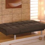 urban brown ikea futon bed design with tuft pattern with metal pole legs on wooden floor with creamy area rug and creamy wall accent