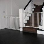vintage home design with white wall and wooden staircase and black concrete flooring idea and baby gate for top stairs