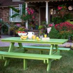 vintage ikea lawn furniture idea with green table and bench on grassy meadow aside garden with concrete walkway