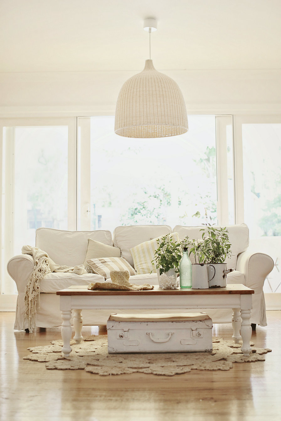 Vintage Living Room Style With White Slipcovered Sofa And Vintage Wooden  Coffee Table Plus Storage Underneath