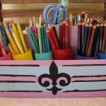 vintage style of colored pencil holder in pink tone with stripe pattern and classic painting