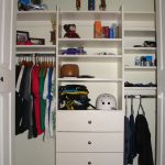 well organized closet organizer for small closet in white color withdrawers and racks and metal hanger