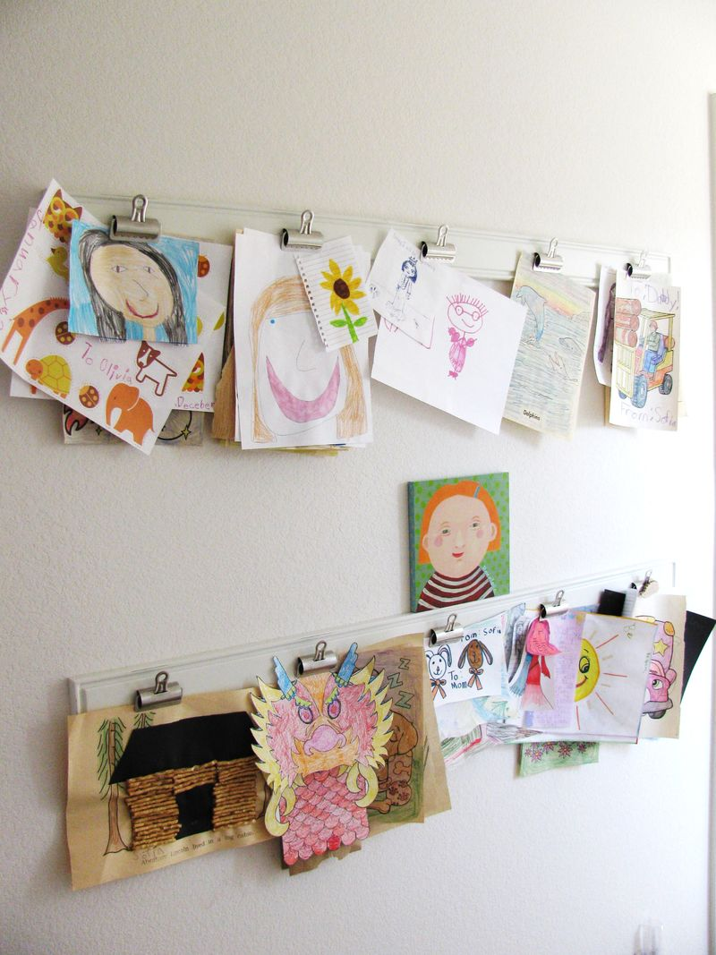White Wall With Pictures And Painting Paper Clip For Displaying Kids Art