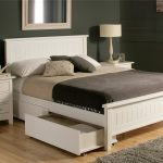 white wooden captain's bed frame smooth white gray beige cushions and bedsheet white wooden furniture classic white lamps greay fur rug flower accent