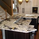 wonderful black and white kitchen design with black island and white giallo rio granite countertop