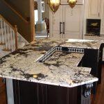 wonderful black and white kitchen design with black island and white giallo rio granite countertop