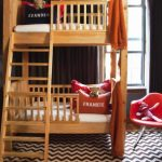 wonderful high crib size bunk bed idea with wooden tone and white bedding set and chevron patterned area rug and red chair