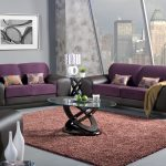 wonderful modern living room with purple black couch with golden loveseat set and unique round glass coffee table on brown area rug with open plan
