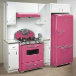 wonderful simple pink retro style appliance kitchen design with modern cooktop and white accent and big refrigerator beneath white storage