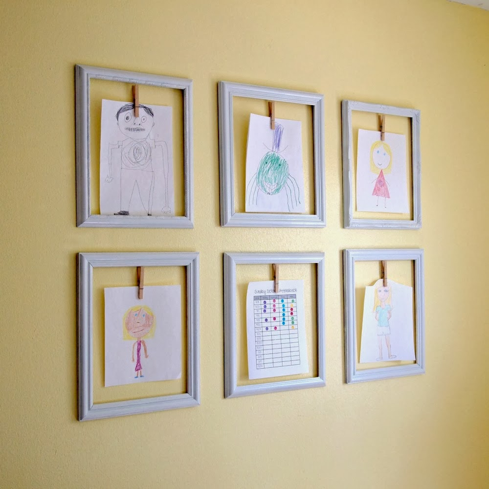 wonderful tidy framed displaying kids art idea with cloth pin on yellow wall
