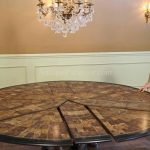 wonderful vintage 84 round dining table idea wth black edge and modular style beneath luxurious chandelier in wainscotted room idea
