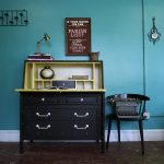 wondrous home office idea with mid century black secretary desk idea with lemonade tone inner storage and black chair beneath blue wall