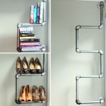 wondrous iron pipe furniture idea of diy wall racks in curve tyle for hoes and books in white color