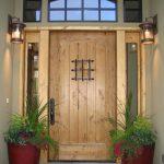 wood front door flowers pot