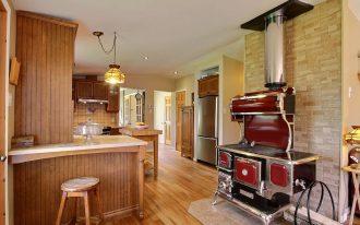 wood stove sountry rug wood chair lamp