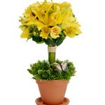 yellow green unusual flower arrangement with beautiful walnut vase