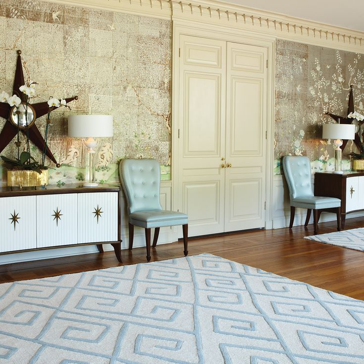 A Global View Rug As A Modern Area Rug A Pair Of Chairs In Torquiose Color