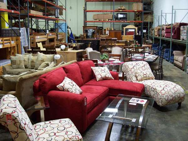 A Group Of Used Furniture Such As Small Sectional With Chaise A Reclining  Sofa Armless Corner