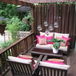 A Lot Of Pink Throw Pillows For Comfy Home Porch Which Is Full Of Wooden Outdoor Furniture Some Series Of Pendant Lamps Dark Brown Porch Drapes