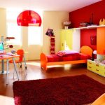 A modern design for kid bedroom which shows an orange single bed furniture with headboard and footboard a storage system in large size in orange and yellow colors modern orange desk orange chair