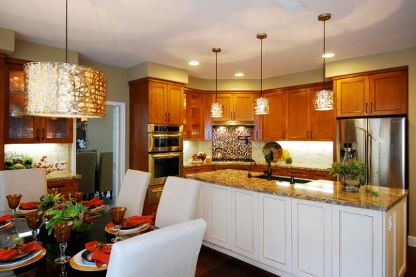 Alita-Champagne-Pendants-over-the-kitchen-island-with-wooden-cabinets-and-champagne-pendant-over-the-dining-table-with-white-chairs