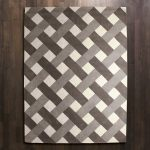 An Area Rug With Diagonal Lines Pattern