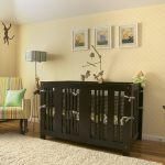 Animal Theme Of Baby Room With Wooden Crib Fur Rug Wallpaper Frames Chair And Floor Lamp