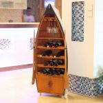 Attractive wine rack that looks like a wooden boat with paddles