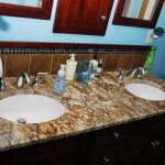 Bathroom Marble Design WIth Two White Sink Double Mirrors Shelfs Above Toilet