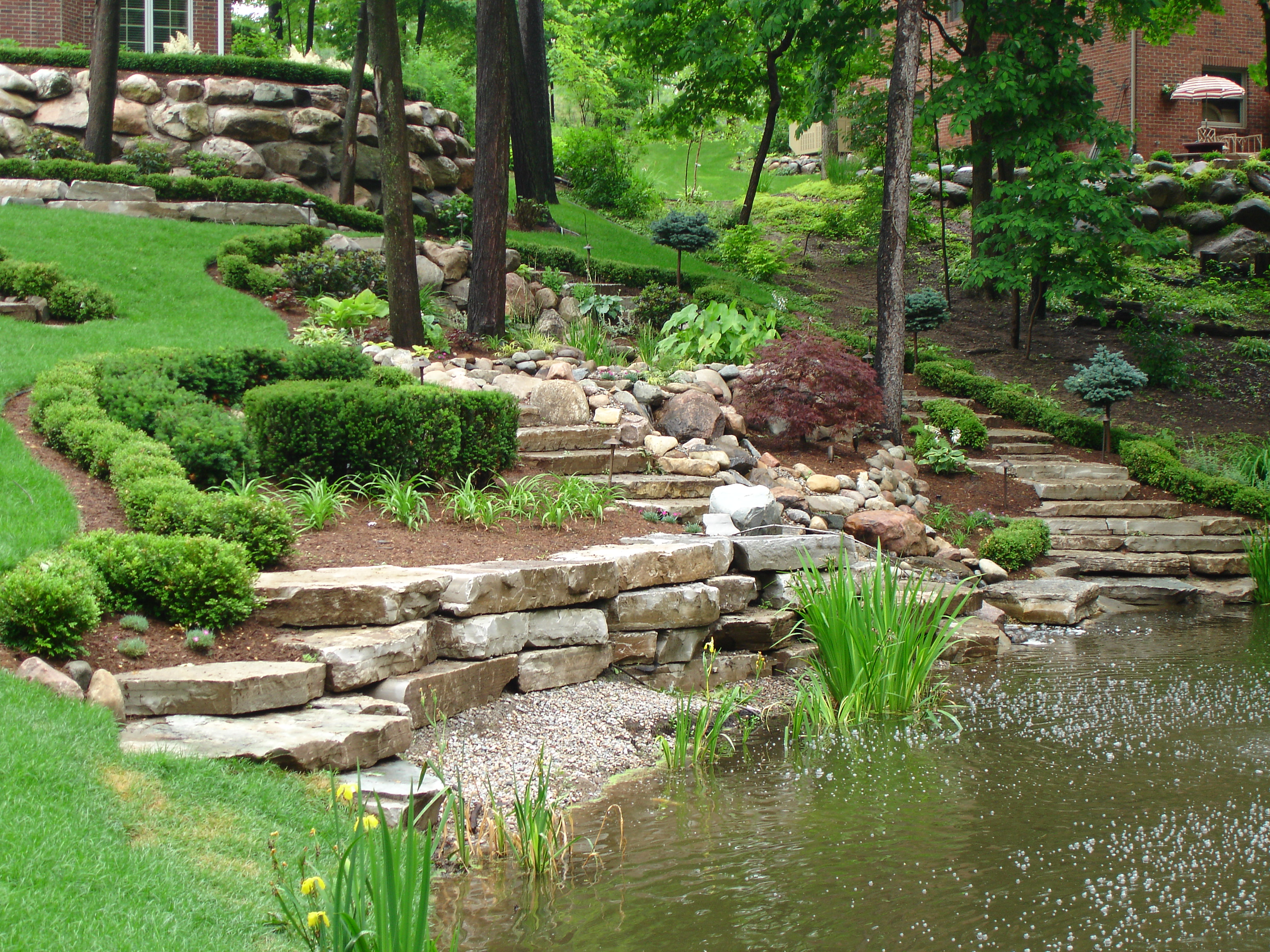 Beatiful Garden With Rocks Stairs And Sloping Design