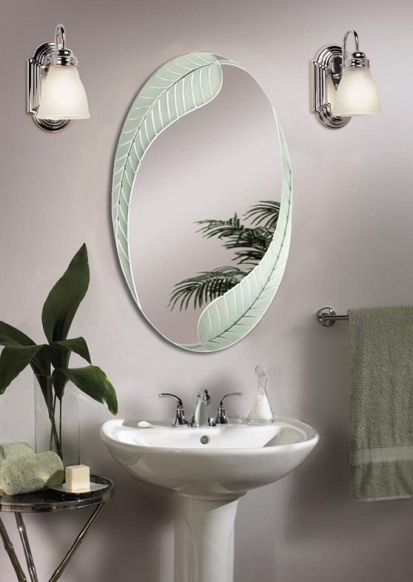 Beautiful Oval Mirror With Leaves Shaped Frame A Small Sink And Faucet A  Pair Of Vanity