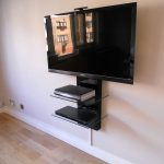 Black Floating Tv Stand With Its Shelf For Books