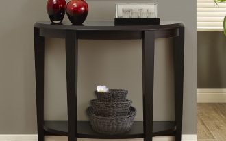 Black Halfmoon Entryway Table With One Shelf With Baskets And Red Vases With Frame Near Fur Rug On Grey Wall