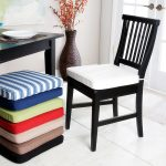 Black Wooden Kitchen Chair With Cushions Near Square Table And Big Vase