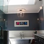 Blue Bathroom Skylight With Chandelier White Bath Tub Sink Glass Door Shower Wooden Cabinet