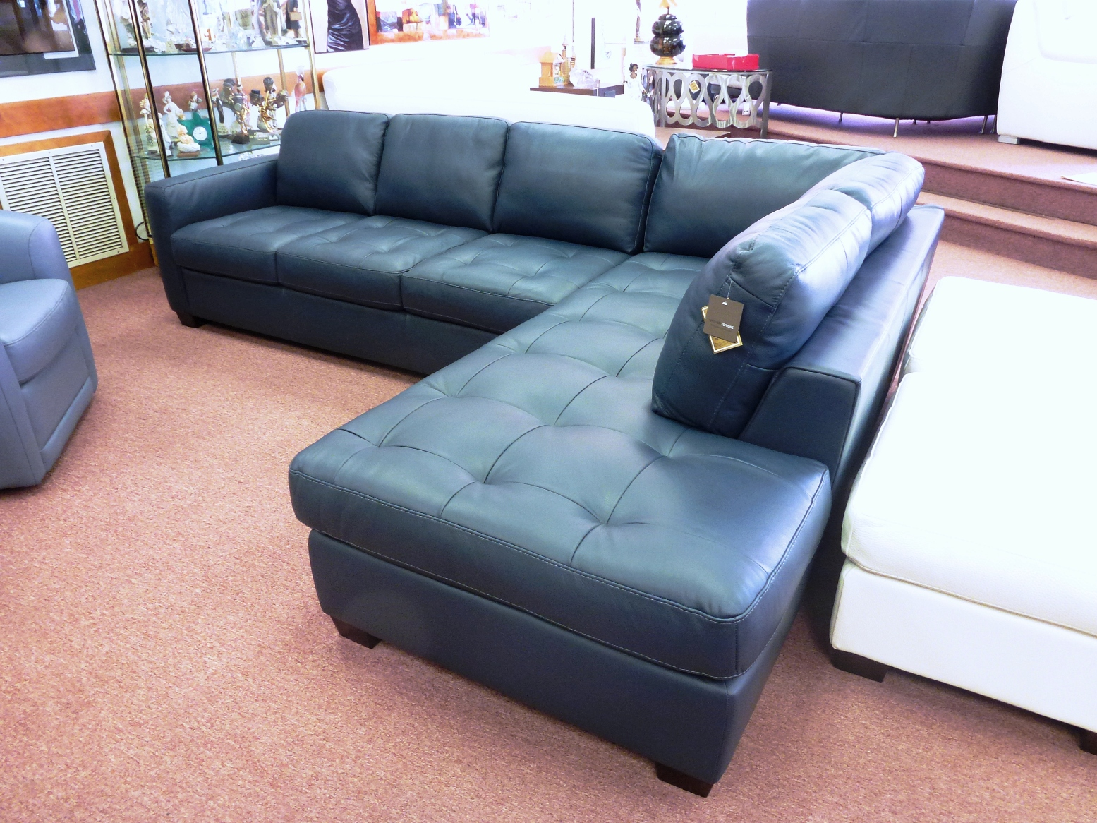 Navy blue sectional sofa design options homesfeed for Blue leather sofa