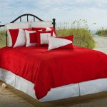 Bright red comforter with red and white pillowcases