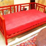 Bright red wooden daybed furniture with red mattresss