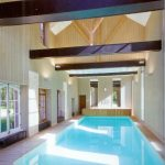 Brilliant Indoor Swimming WIth Exposing Beams