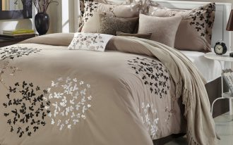 Brown And Glow Bedding On Its Bed Cover And Pillows With Grey Carpet In Warm Bedroom