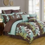 Brown and teal bedding idea for king bed frame with white headboard a wooden bedside table with two drawers a modern table lamp with beautiful clear crystal stand