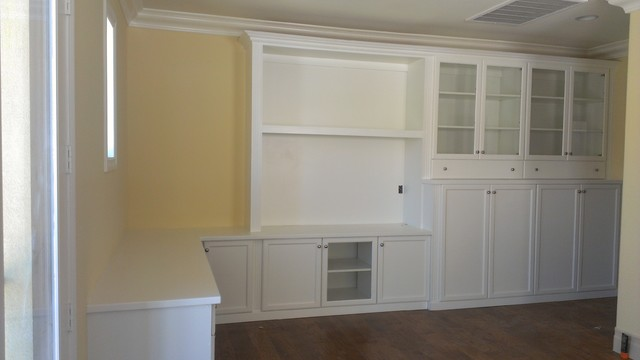 Built In Shelving Unit And Cabinets With Desk