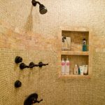 Built in shower shelving unit for displaying and organizing bath supplies black brushed iron showerhead mounted on wall