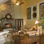 Classic Living Room with Stone Fireplace and Lamp with Fan plus Warm Sofa near The Wooden Cabinet